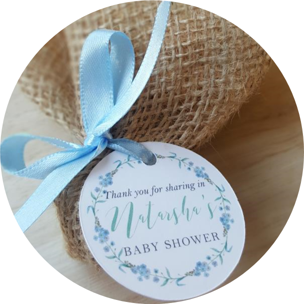 baby shower seed bomb wrapped in burlap with gift tag